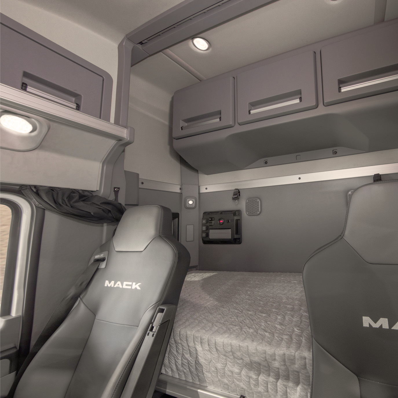 """Driver view of the Anthem 36"""" Stand Up Sleeper interior environment with sleeper bunk.."""